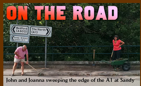 On The Road - John and Joanna sweeping the edge of the A1 at Sandy
