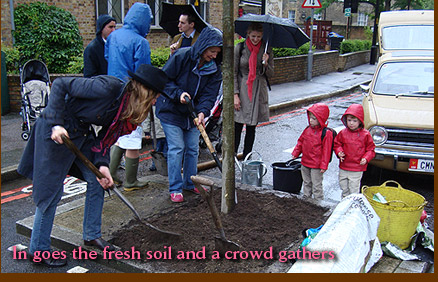 In goes the fresh soil and a crowd gathers
