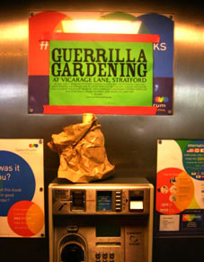Guerrilla gardening propaganda in a phone box